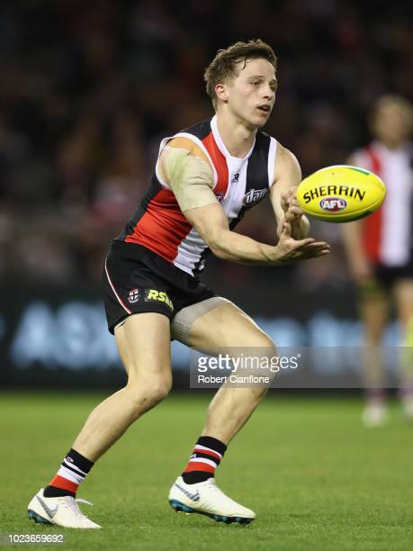Jack Billings of the Saints handballs during the round 23 AFL match between the St Kilda Saints and the North Melbourne Kangaroos at Etihad Stadium...