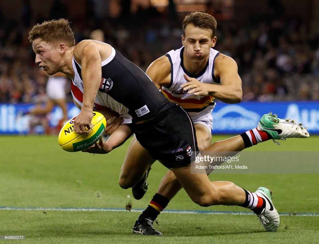 Jack Billings of the Saints is tackled by Tom Doedee of the Crows during the 2018 AFL round 03 match between the St Kilda Saints and the Adelaide Crows at Etihad Stadium on April 7, 2018 in Melbourne, Australia.
