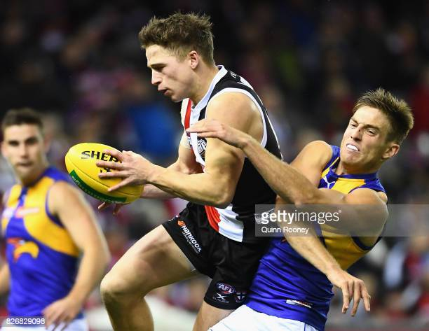 Jack Billings of the Saints marks over the top of Brad Sheppard of the Eagles during the round 20 AFL match between the St Kilda Saints and the West...