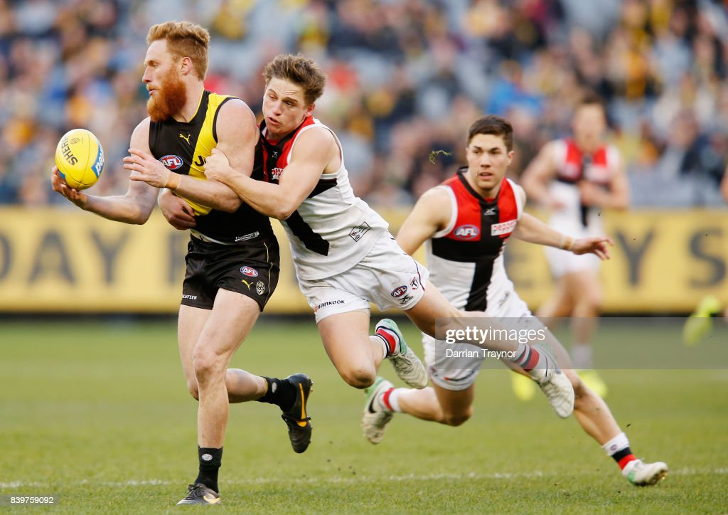 Jack Billings of the Saints tackles Nick Vlastuin of the Tigers during the round 23 AFL match between the Richmond Tigers and the St Kilda Saints at Melbourne Cricket Ground on August 27, 2017 in Melbourne, Australia.