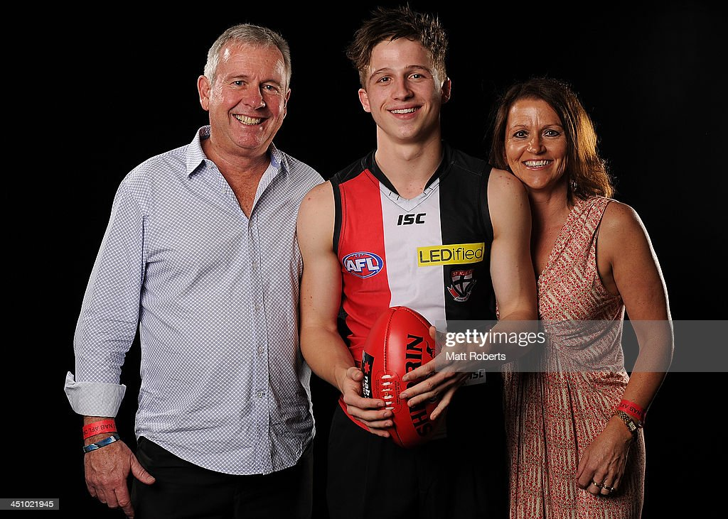 Jack Billings poses for a photograph with his father Graeme and mother Letitia after being drafted to St Kilda during the 2013 NAB AFL Draft on November 21, 2013 on the Gold Coast, Australia.