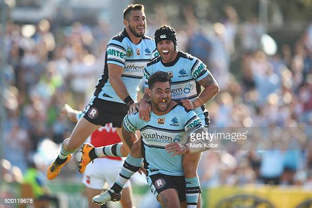 Jack Bird, Michael Ennis and Andrew Fifita of the Sharks celebrate Andrew Fifita scoring a try during the round six NRL match between the Cronulla...