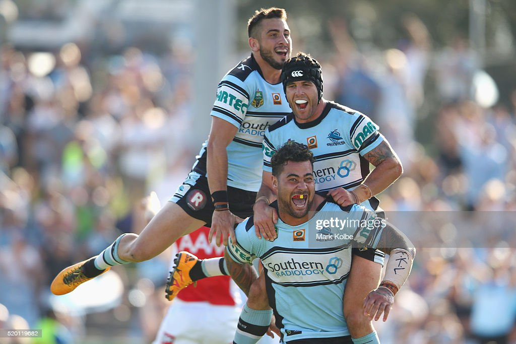 Jack Bird, Michael Ennis and Andrew Fifita of the Sharks celebrate Andrew Fifita scoring a try during the round six NRL match between the Cronulla Sharks and the Gold Coast Titans at Southern Cross Group Stadium on April 10, 2016 in Sydney, Australia.