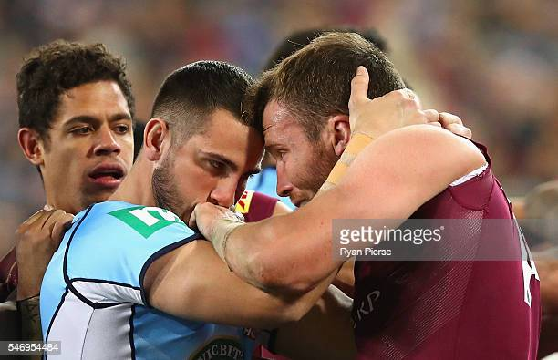 Jack Bird of the Blues and Gavin Cooper of the Maroons clash during game three of the State Of Origin series between the New South Wales Blues and...