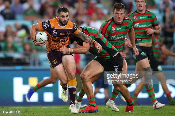 Jack Bird of the Broncos is tackled during the round eight NRL match between the South Sydney Rabbitohs and the Brisbane Broncos at ANZ Stadium on...