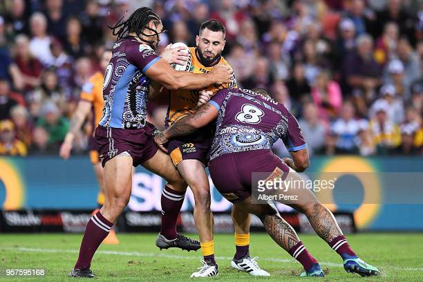 Jack Bird of the Broncos is tackled during the round ten NRL match between the Manly Sea Eagles and the Brisbane Broncos at Suncorp Stadium on May 12...