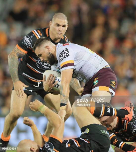 Jack Bird of the Broncos is tackledduring the round three NRL match between the Wests Tigers and the Brisbane Broncos at Campbelltown Sports Stadium...