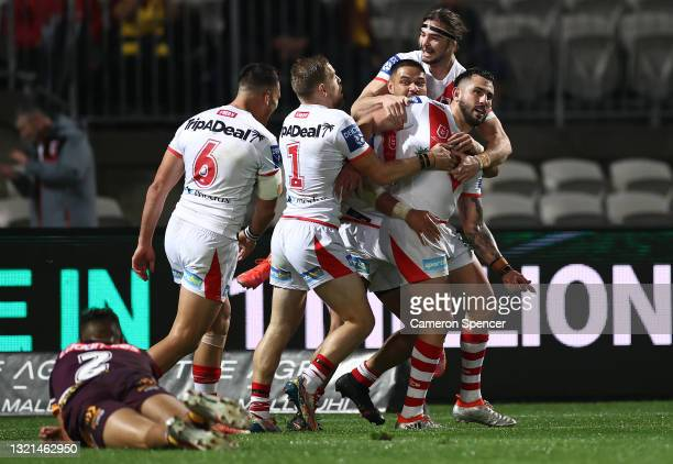 Jack Bird of the Dragons celebrates after scoring a try during the round 13 NRL match between the St George Illawarra Dragons and the Brisbane...
