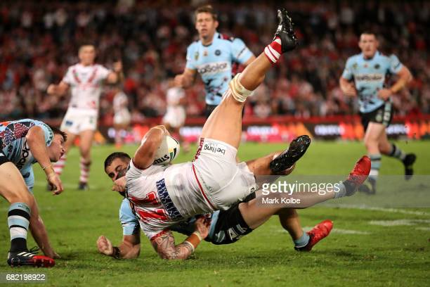 Jack Bird of the Sharks flips Tyson Frizell of the Dragons during the round 10 NRL match between the St George Illawarra Dragons and the Cronulla...