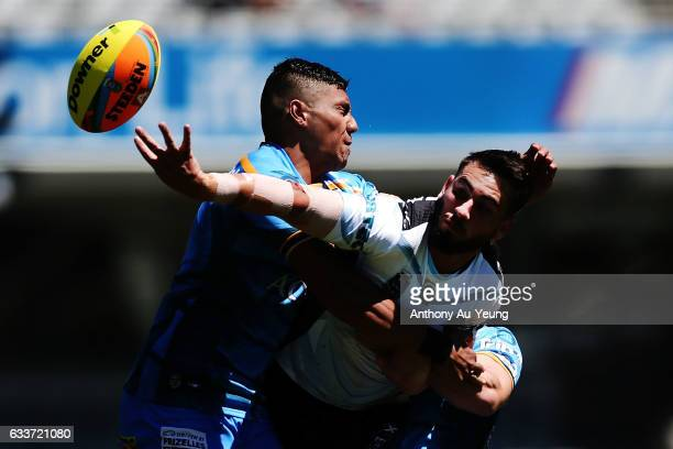 Jack Bird of the Sharks is tackled by John Olive of the Titans during the 2017 Auckland Nines match between the Sharks and the Titans at Eden Park on...