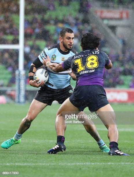 Jack Bird of the Sharks is tackled by Young Tonumaipea of the Melbourne Storm during the round six NRL match between the Melbourne Storm and the...