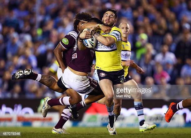 Jack Bird of the Sharks is tackled during the round 26 NRL match between the Cronulla Sharks and the Manly Sea Eagles at Remondis Stadium on...