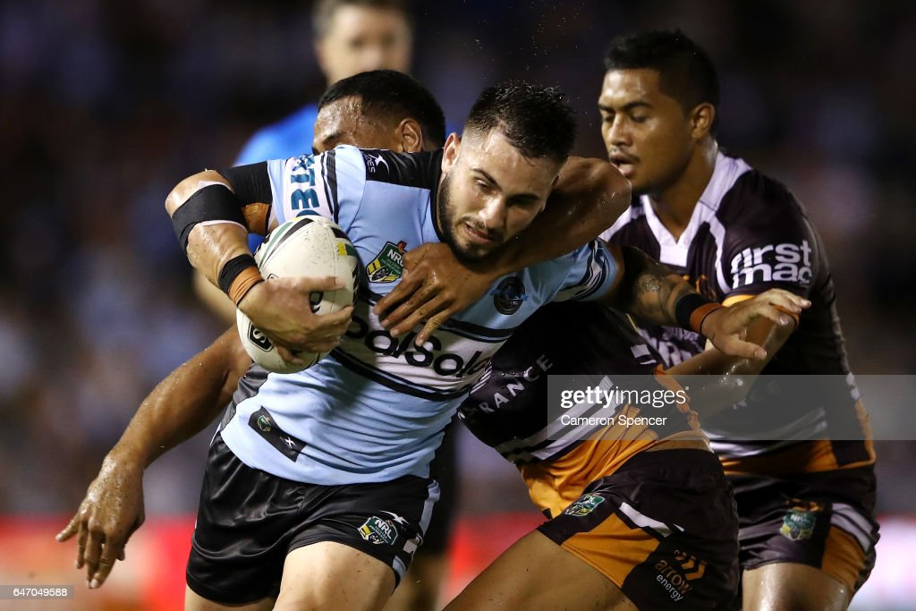 Jack Bird of the Sharks is tackled during the round one NRL match between the Cronulla Sharks and the Brisbane Broncos at Southern Cross Group Stadium on March 2, 2017 in Sydney, Australia.