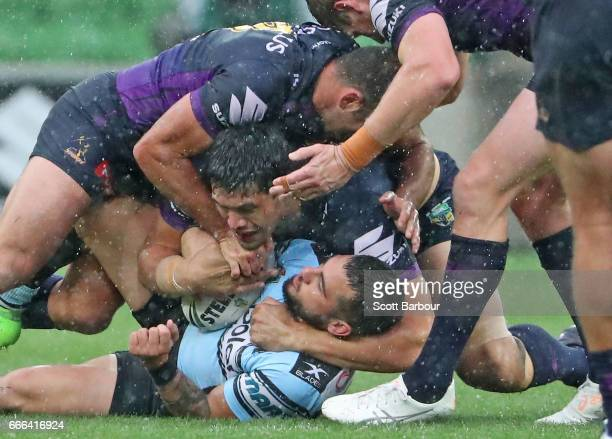 Jack Bird of the Sharks is tackled during the round six NRL match between the Melbourne Storm and the Cronulla Sharks at AAMI Park on April 9 2017 in...