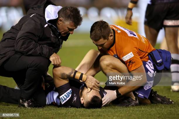Jack Bird of the Sharks lies on the ground with an injury during the round 22 NRL match between the Cronulla Sharks and the Canberra Raiders at...