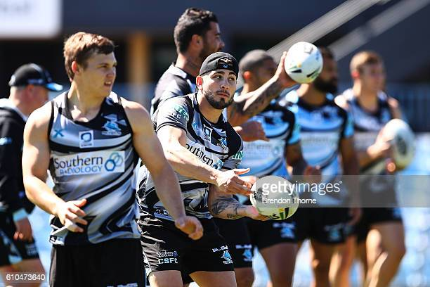 Jack Bird of the Sharks passes the ball to a team mate during a Cronulla Sharks NRL training session at Southern Cross Group Stadium on September 26...