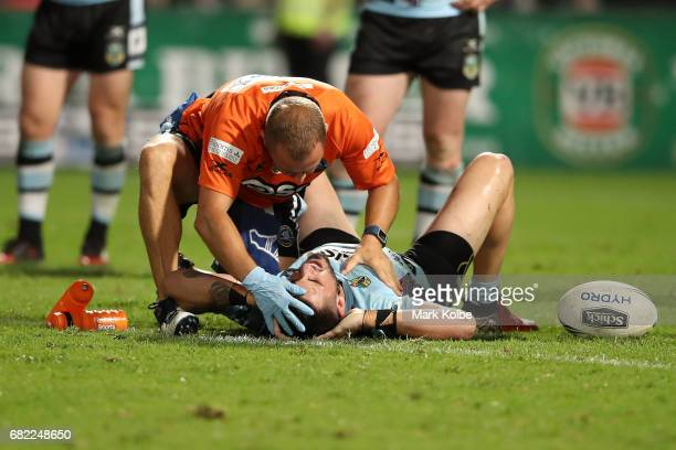 Jack Bird of the Sharks receieves attention from the trainer during the round 10 NRL match between the St George Illawarra Dragons and the Cronulla...