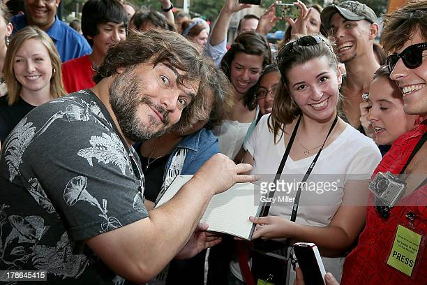 Jack Black interacts with fans on the red carpet during the ten year anniversary screening of School of Rock at the Paramount Theatre on August 29...