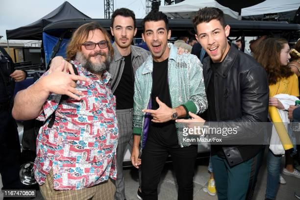 Jack Black with honorees Kevin Jonas, Joe Jonas and Nick Jonas of Jonas Brothers attend FOX's Teen Choice Awards 2019 on August 11, 2019 in Hermosa...