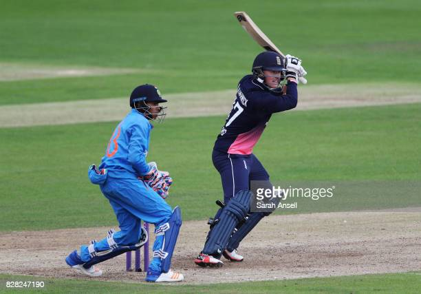 Jack Blatherwick of England U19s hits out as India U19s wicket keeper Het Patel looks on during the match between England Under 19s and India U19s at...