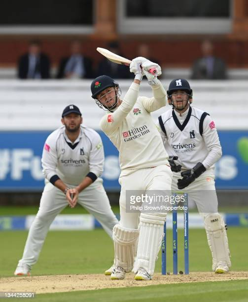 Jack Blatherwick of Lancashire hits a six watched by Tim Bresnan and Michael Burgess of Warwickshire during the Bob Willis Trophy Final between...