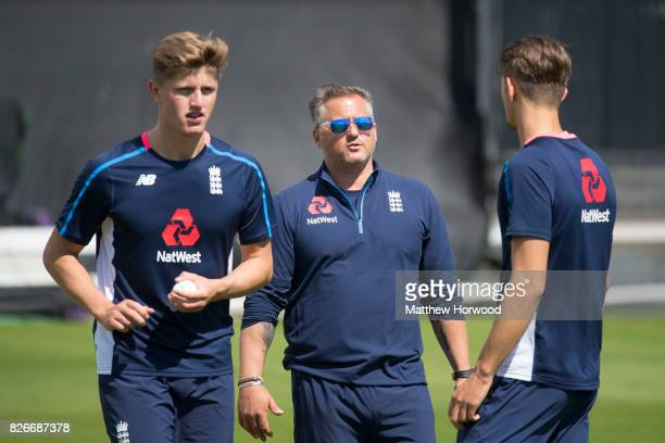 Jack Blatherwick prepares to bowl while Darren Gough speaks to Jack Plom during England U19 cricket training at the SSE Swalec Stadium on August 5...