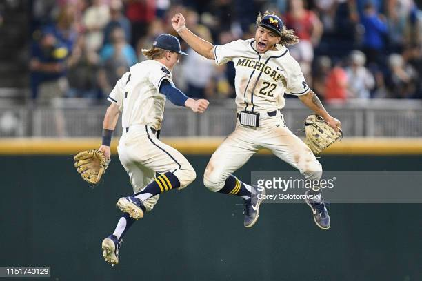Jack Blomgren and Jordan Brewer of the Michigan Wolverines celebrate after defeating the Vanderbilt Commodores during the Division I Men's Baseball...