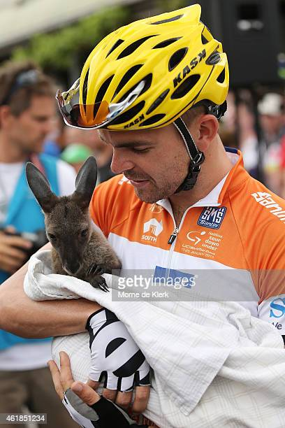 Jack Bobridge of Australia and the UniSA-Australia team holds a baby kangaroo before the start of stage 2 of the 2015 Santos Tour Down Under on...