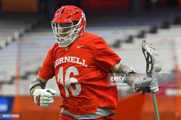Jack Bolen of the Cornell Big Red controls the ball against the Syracuse Orange during a 2018 NCAA Division I Men's Lacrosse Championship First Round...