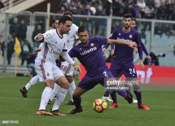 Jack Bonaventura of AC Milan vies with Vincent Laurini of ACF Fiorentina during Italy Serie A soccer match between ACF Fiorentina and AC Milan at...