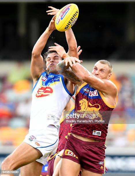 Jack Bowes of the Suns and Mitch Robinson of the Lions challenge for the ball during the round five AFL match between the Brisbane Lions and the Gold...