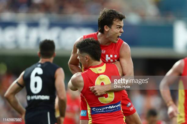 Jack Bowes of the Suns celebrates a goal during the round four AFL match between the Gold Coast Suns and the Carlton Blues at Metricon Stadium on...
