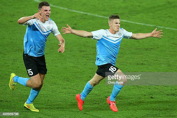Jack Boxell celebrates with team mate Eoghan Murphy after kicking a goal during the FFA Cup match between the Palm Beach Sharks and South Springvale...