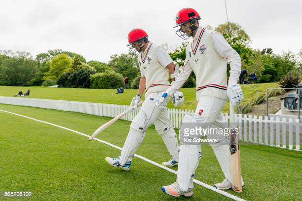 Jack Boyle and Chad Bowes of Canterbury walk out to bat during the Plunket Shield match between Canterbury and the Otago Volts on October 23 2017 in...