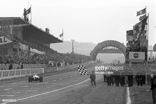 Jack Brabham CooperClimax T53 Grand Prix of France ReimsGueux 03 July 1960 Jack Brabham crosses the finish line and takes the checkered flag winning...