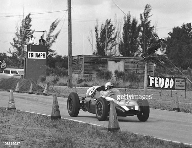 Jack Brabham negotiates the track in his Cooper T51 F2-4-59/Climax during the running of the 2nd United States Grand Prix FIA Formula One race at...