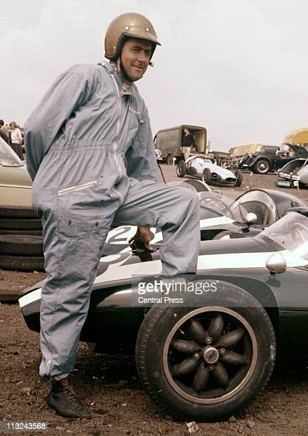 Jack Brabham poses with his Cooper Car Company Cooper T45 Climax FPF before the I Kent Trophy Race for Formula Two on 4th August 1958 at the Brands...
