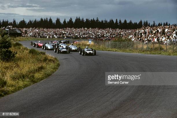 Jack Brabham, Stirling Moss, Cooper-Climax T55, Lotus-Climax 18, Grand Prix of Germany, Nurburgring, Germany, August 6, 1961.