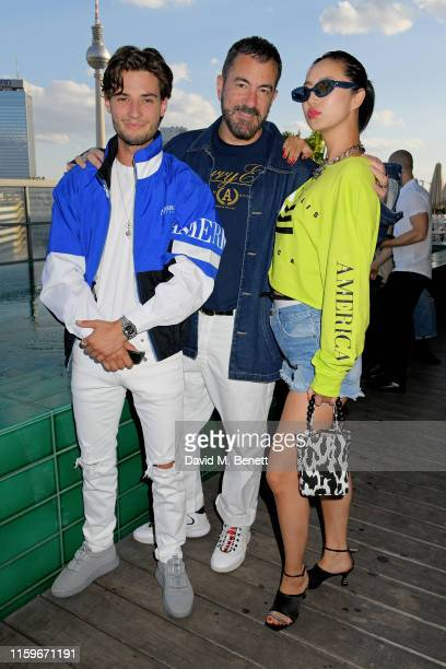 Jack Brett Anderson, Michael Maccari and Betty Bachz attend the Perry Ellis America pool party at Soho House Berlin to celebrate their European...