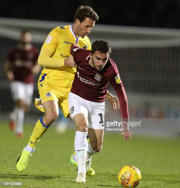 Jack Bridge of Northampton Town attempts to move forward with the ball under pressure from Alex Rodman of Bristol Rovers during the Checkatrade...