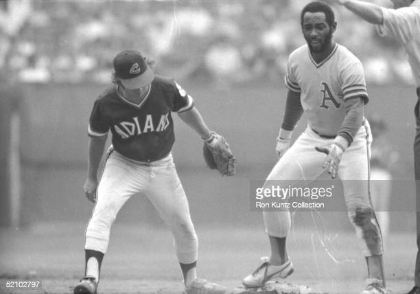 Jack Brohamer of the Cleveland Indians applies the tag too late to Billy North of the Oakland A's during a game on June 20 1975 at Municipal Stadium...