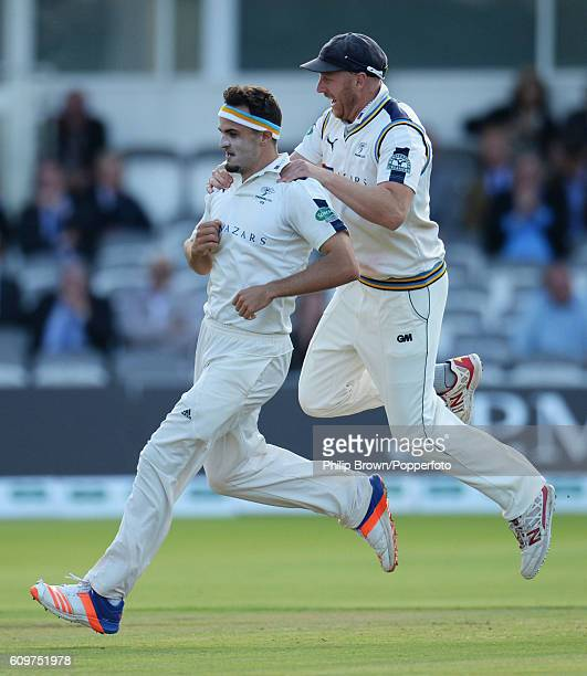 Jack Brooks and Andrew Gale of Yorkshire celebrate after the dismissal of Nick Compton during day three of the Specsavers County Championship...