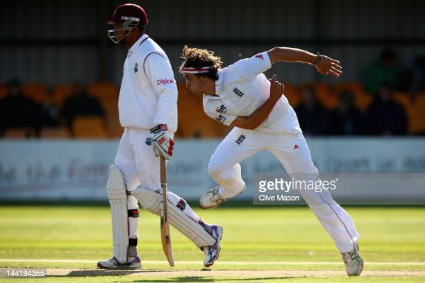 Jack Brooks of England Lions in action bowling as Kieran Powell of West Indies looks on during day two of the tour match between England Lions and...