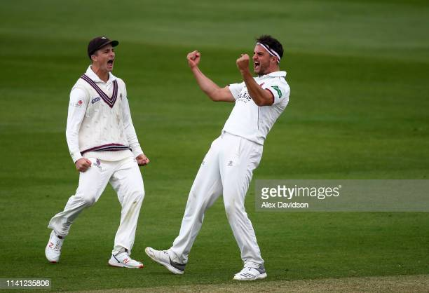Jack Brooks of Somerset celebrates the wicket of Harry Podmore with Tom Abell during Day 4 of the Specsavers County Championship Division One match...