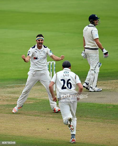 Jack Brooks of Yorkshire celebrates taking the wicket of Nick Compton of Middlesex with Andrew Gale of Yorkshire during day one of the Specsavers...