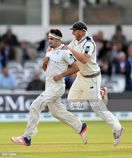 Jack Brooks of Yorkshire celebrates with Andrew Gale of Yorkshire after taking the wicket of Nick Compton of Middlesex during day three of the...