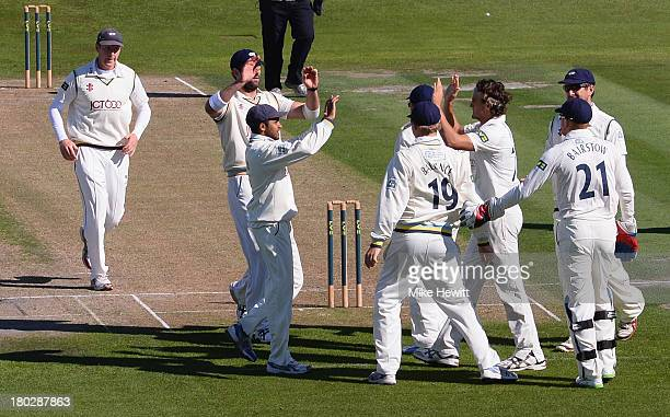 Jack Brooks of Yorkshire is congratulated by team mates after dismissing Luke Wells of Sussex during the LV County Championship match between Sussex...