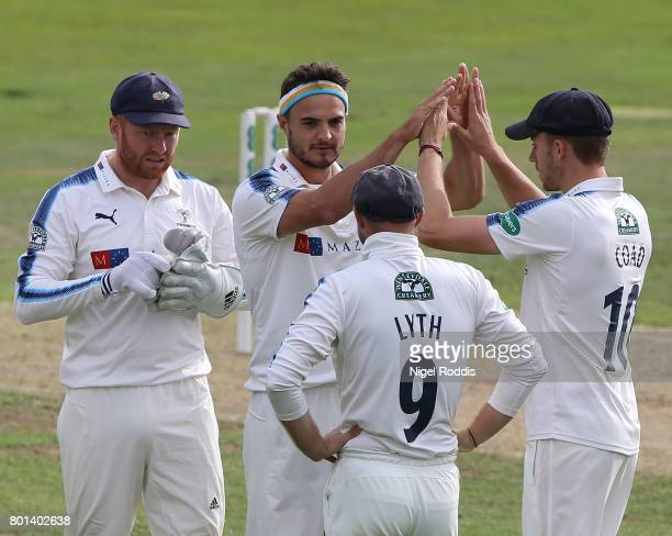 Jack Brooks of Yorkshire reacts with teamates after taking the wicket of Jason Roy of Surrey during the Specsavers County Championship Division One...