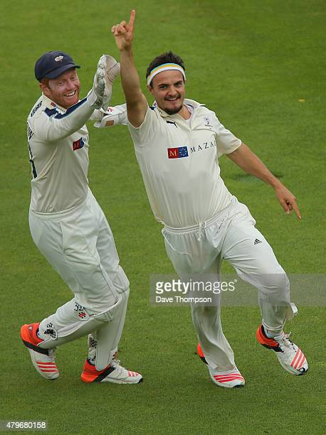 Jack Brooks of Yorkshire right celebrates with Jonny Bairstow of Yorkshire after taking the wicket of Jonathan Trott of Warwickshire during day two...