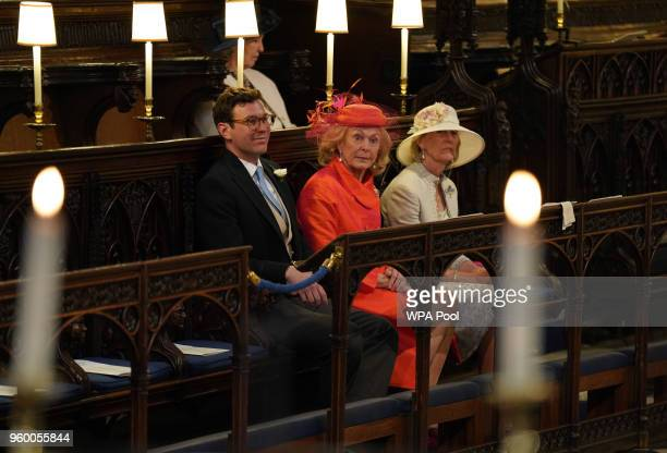 Jack Brooksbank and Emilie van Cutsem take their seats at St George's Chapel at Windsor Castle before the wedding of Prince Harry to Meghan Markle on...